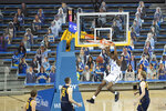 UCLA guard Chris Smith (5) slams a dunk during the first half of an NCAA college basketball game against California, Sunday, Dec. 6, 2020, in Los Angeles. (AP Photo/Kyusung Gong)