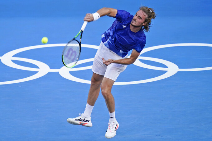 Stefanos Tsitsipas, of Greece, plays Philipp Kohlschreiber, of Germany, during the first round of the tennis competition at the 2020 Summer Olympics, Sunday, July 25, 2021, in Tokyo, Japan. (AP Photo/Seth Wenig)