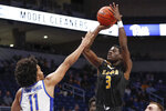 Arkansas-Pine Bluff's Markedric Bell (3) shoots over Pittsburgh's Justin Champagnie (11) during the first half of an NCAA college basketball game Thursday, Nov. 21, 2019, in Pittsburgh. (AP Photo/Keith Srakocic)