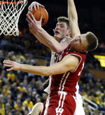 Michigan center Jon Teske, left, pulls down a rebound next to Wisconsin guard Brad Davison (34) during the second half of an NCAA college basketball game, Saturday, Feb. 9, 2019, in Ann Arbor, Mich. (AP Photo/Carlos Osorio)