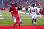 Utah running back Tavion Thomas (9) scores a touchdown during the first half of the team's NCAA college football game against Weber State on Thursday, Sept. 2, 2021, in Salt Lake City. (AP Photo/Rick Bowmer)