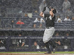 Chicago White Sox James McCann approaches the plate after hitting a home run against the New York Yankees during the seventh inning of a baseball game Friday, April 12, 2019, in New York. (AP Photo/Michael Owens)