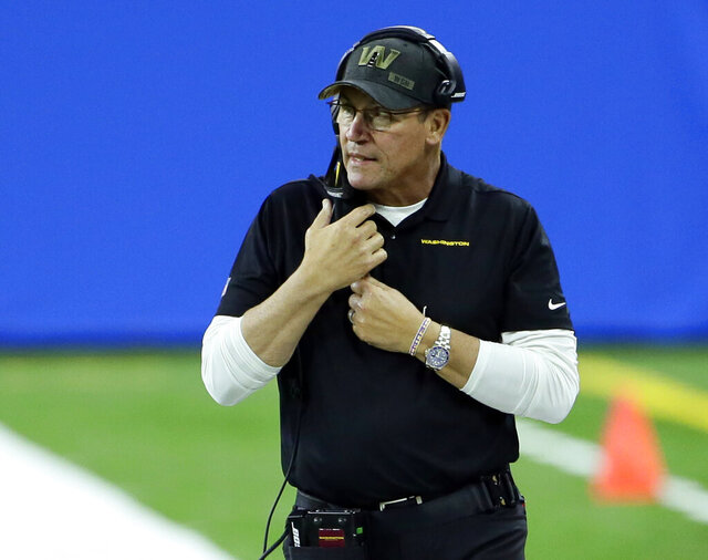 FILE - In this Nov. 15, 2020, file photo, Washington Football Team head coach Ron Rivera watches against the Detroit Lions during the second half of an NFL football game in Detroit. The mess for a franchise that finally dropped a nickname considered racist also has included harassment claims from former club employees and reporters, and a battle over minority ownership stakes. Those are beyond Rivera's reach, but as he recalled about a phone call just after he was fired by the Panthers last December with Washington team owner Daniel Snyder, Rivera's charge was more than what happens between the sidelines. (AP Photo/Duane Burleson, File)