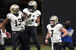 New Orleans Saints running back Alvin Kamara (41) celebrates his touchdown with New Orleans Saints wide receiver Michael Thomas (13) against the Atlanta Falcons during the second half of an NFL football game, Sunday, Dec. 6, 2020, in Atlanta. (AP Photo/Brynn Anderson)