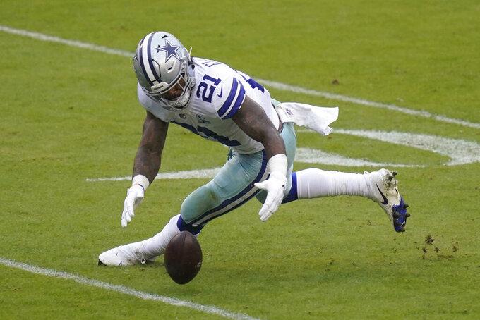 Dallas Cowboys running back Ezekiel Elliott (21) recovering a loose football during the second half of an NFL football game, Sunday, Oct. 25, 2020, in Landover, Md. (AP Photo/Patrick Semansky)