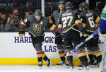 Vegas Golden Knights right wing Mark Stone, left, celebrates after scoring against the Vancouver Canucks during the second period of an NHL hockey game Sunday, Dec. 15, 2019, in Las Vegas. (AP Photo/John Locher)
