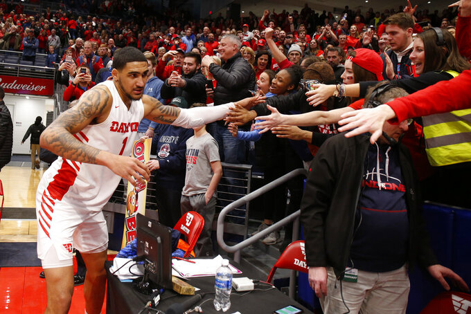 Dayton forward Obi Toppin interacts with fans following the team's 82-67 win over Davidson in an NCAA college basketball game Friday, Feb. 28, 2020, in Dayton, Ohio.(AP Photo/Gary Landers)