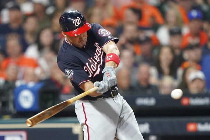 """FILE - In this Oct. 22, 2019, file photo, Washington Nationals' Ryan Zimmerman hits a home run during the second inning of Game 1 of the baseball World Series against the Houston Astros in Houston. A person familiar with the negotiations tells the AP that """"face of the franchise"""" Zimmerman and the Nationals have agreed to terms on a $2 million deal for 2020. The deal is pending a physical. (AP Photo/David J. Phillip, File)"""