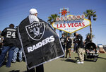 "FILE - In this April 29, 2017, file photo, Oakland Raiders fans attend an NFL football draft event in Las Vegas. Tourism officials in Las Vegas are allocating $2.4 million to host the NFL draft in a little more than 10 weeks. The Las Vegas Convention and Visitors Authority board on Tuesday, Feb. 11, 2020, approved a budget for promotions, police, ""marquee event elements,"" and $500,000 for contracts to be signed by the authority chief executive. (AP Photo/John Locher, File)"