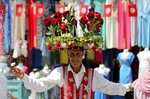 A flower seller is pictured at the old market in Tunis, Tunisia, Friday, July 30, 2021. Days of political turmoil in Tunisia over the economy and the coronavirus have left its allies in the Middle East, Europe and the United States watching to see if the fragile democracy will survive. (AP Photo/Hassene Dridi)