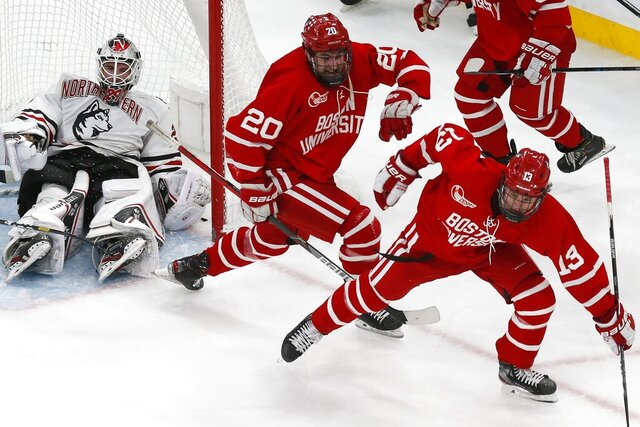 Boston University's Trevor Zegras (13) celebrates his tying goal against Northeastern's Craig Pantano, left, during the third period of the Beanpot Tournament championship NCAA college hockey game in Boston, Monday, Feb. 10, 2020. (AP Photo/Michael Dwyer)