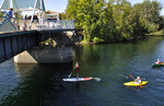 FILE - In this August 2014, file photo, paddlers head under the Don Kardong Bridge as they enjoy the Spokane River just upstream from downtown Spokane, Wash. The Spokane real estate market is booming. Spokane County's median home price in May 2021 reached another all-time high at $375,000. That was 29.5% greater than the $289,900 median in May 2020, according to the Spokane Association of Realtors. (Rich Landers/The Spokesman-Review via AP, File)