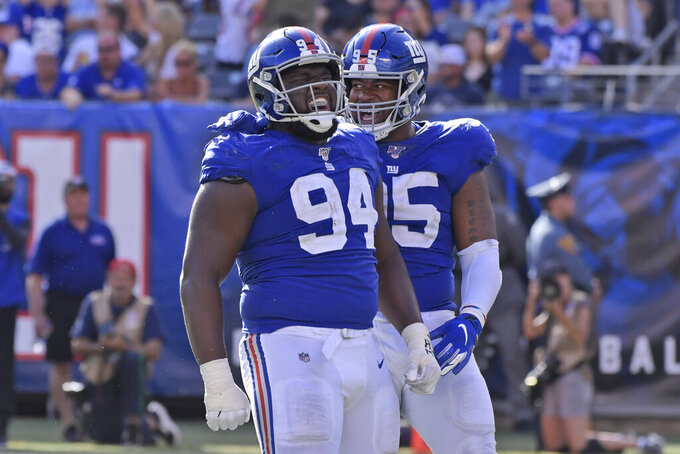 New York Giants' Dalvin Tomlinson, left, and B.J. Hill celebrates after a sack during the second half of an NFL football game against the Washington Redskins, Sunday, Sept. 29, 2019, in East Rutherford, N.J. (AP Photo/Bill Kostroun)