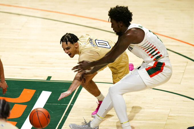 Georgia Tech guard Michael Devoe (0)and Miami center Nysier Brooks go for a loose ball during the first half of an NCAA college basketball game, Saturday, Feb. 20, 2021, in Coral Gables, Fla. (AP Photo/Lynne Sladky)