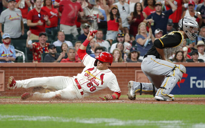 St. Louis Cardinals' Lars Nootbaar (68) scores from first base on a double by Edmundo Sosa as Pittsburgh Pirates catcher Jacob Stallings, right, bobbles the ball in the sixth inning of a baseball game, Saturday, Aug. 21, 2021, in St. Louis. (AP Photo/Tom Gannam)