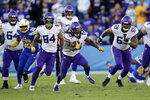 Minnesota Vikings running back Mike Boone runs with the ball during the second half of an NFL football game against the Los Angeles Chargers, Sunday, Dec. 15, 2019, in Carson, Calif. (AP Photo/Marcio Jose Sanchez)