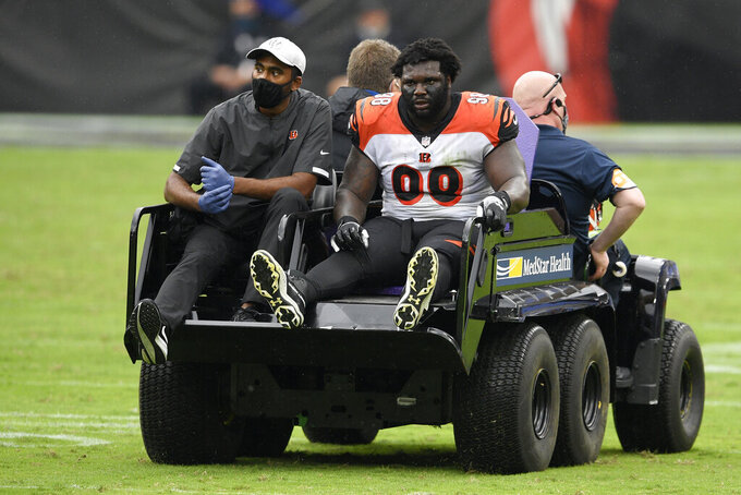 Cincinnati Bengals nose tackle D.J. Reader (98) is carted away after he was injured during the second half of an NFL football game against the Baltimore Ravens, Sunday, Oct. 11, 2020, in Baltimore. Reader suffered a season-ending knee injury. Free agent DT Xavier Williams was signed Monday to replace him. (AP Photo/Nick Wass)
