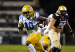 UCLA running back Demetric Felton, front, runs for a touchdown past Colorado defensive tackle Jalen Sami in the second half of an NCAA college football game Saturday, Nov. 7, 2020, in Boulder, Colo. (AP Photo/David Zalubowski)
