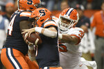 Clemson's Justin Foster, right, rushes Syracuse quarterback Tommy DeVito during the first half of an NCAA college football game Saturday, Sept. 14, 2019, in Syracuse, N.Y. (AP Photo/Steve Jacobs)