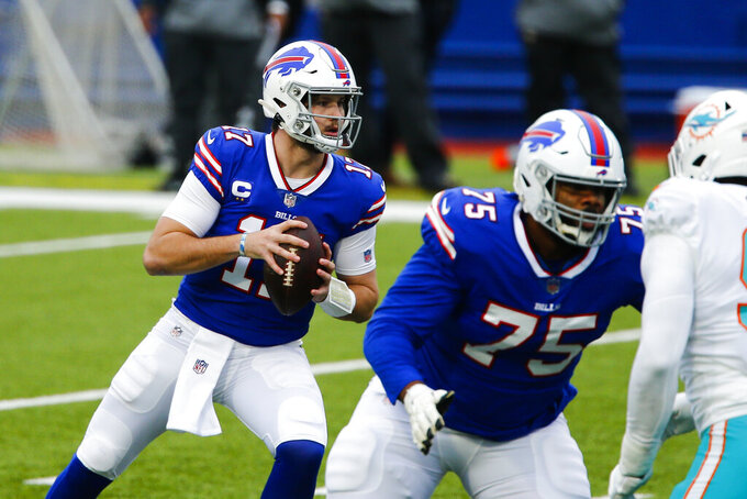 Buffalo Bills quarterback Josh Allen (17) looks to pass in the first half of an NFL football game against the Miami Dolphins, Sunday, Jan. 3, 2021, in Orchard Park, N.Y. (AP Photo/John Munson)