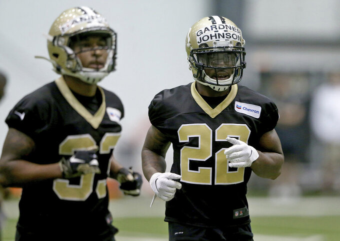 New Orleans Saints defensive backs Saquon Hampton (33) and Chauncey Gardner-Johnson (22) jog during NFL football rookie camp at the team's headquarters in Metairie, La., Saturday, May 11, 2019. (Michael DeMocker/The Times-Picayune via AP)