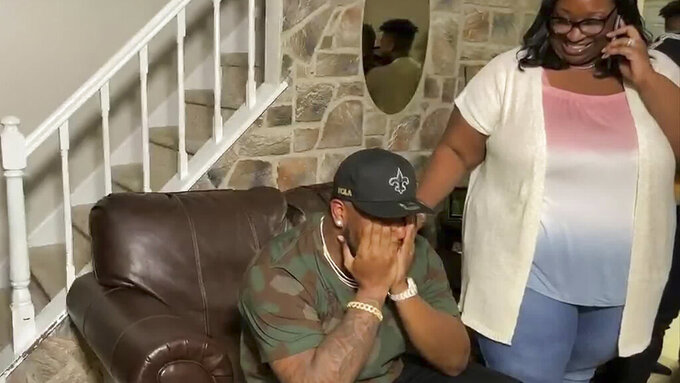 In this still image from video provided by the NFL, Cesar Ruiz reacts after being drafted by the New Orleans Saints during the first round of the NFL football draft Thursday, April 23, 2020. (NFL via AP)