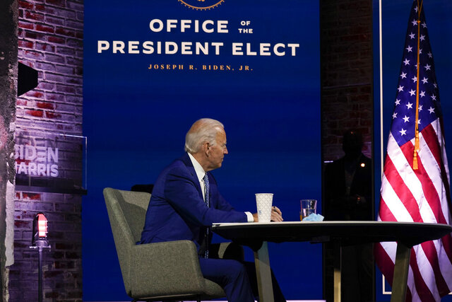 President-elect Joe Biden listens during a meeting with his COVID-19 advisory council, Monday, Nov. 9, 2020, at The Queen theater in Wilmington, Del. (AP Photo/Carolyn Kaster)