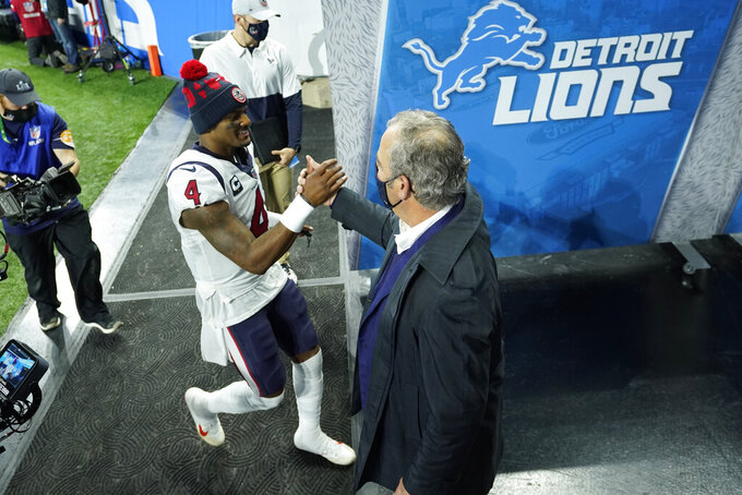 Houston Texans quarterback Deshaun Watson (4) shakes hands with team CEO Cal McNair after an NFL football game against the Detroit Lions, Thursday, Nov. 26, 2020, in Detroit. (AP Photo/Paul Sancya)
