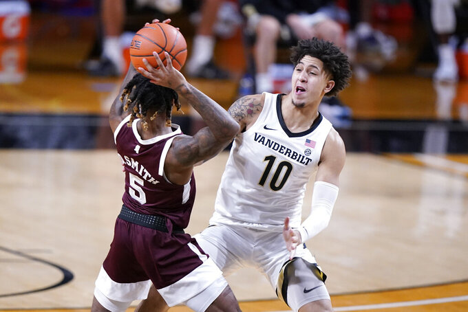 Vanderbilt forward Myles Stute (10) guards Mississippi State guard Deivon Smith (5) in the first half of an NCAA college basketball game Saturday, Jan. 9, 2021, in Nashville, Tenn. (AP Photo/Mark Humphrey)