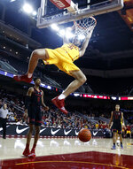 Southern California's Nick Rakocevic, front, dunks against Stanford during the first half of an NCAA college basketball game Sunday, Jan. 6, 2019, in Los Angeles. (AP Photo/Ringo H.W. Chiu)