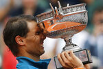 FILE - In this June 10, 2018, file photo, Spain's Rafael Nadal reacts after defeating Austria's Dominic Thiem in the men's final match of the French Open tennis tournament in Paris. Nadal is expected to compete for his 13th French Open trophy, The tournament begins on Sunday, Sept. 27., 2020.(AP Photo/Thibault Camus, File)