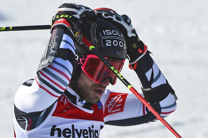 France's Mathieu Faivre reacts after winning the gold medal in a men's giant slalom, at the alpine ski World Championships, in Cortina d'Ampezzo, Italy, Friday, Feb. 19, 2021. (AP Photo/Marco Tacca)