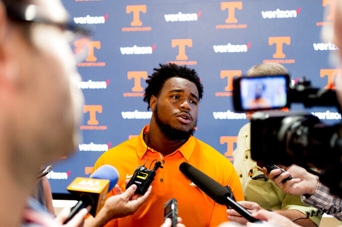 FILE - In this Aug. 9, 2018, file, photo, Tennessee offensive lineman Brandon Kennedy answers questions during a news conference in Knoxville, Tennessee. Brandon Kennedy already has a master's degree in sports psychology and is working on a second as the offensive lineman is back for a rare sixth college season. The center who started his career at Alabama before transferring chose to try playing one final year on a Tennessee offensive line that finally has talent and depth. (Calvin Mattheis, The News Sentinel via AP, File)