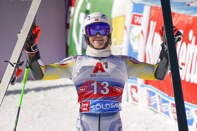 Norway's Lucas Braathen celebrates in the finish area after completing alpine ski, men's World Cup giant slalom in Soelden, Austria, Sunday, Oct. 18, 2020.. (AP Photo/Giovanni Auletta)