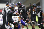 Cincinnati Bearcats cornerback Cameron Jefferies (14), center, reacts after recovering a fumble during an NCAA college football game, against East Carolina Friday, Nov. 23, 2018, in Cincinnati.   (Kareem Elgazzar/The Cincinnati Enquirer via AP)