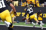 Iowa defensive back Riley Moss (33) celebrates after returning an interception 30-yards for a touchdown during the first half of an NCAA college football game against Indiana, Saturday, Sept. 4, 2021, in Iowa City, Iowa. (AP Photo/Charlie Neibergall)