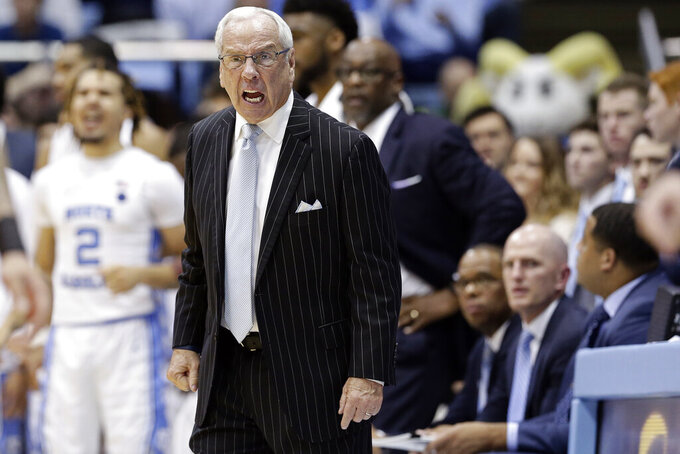 North Carolina head coach Roy Williams reacts during the second half of an NCAA college basketball game against Ohio State in Chapel Hill, N.C., Wednesday, Dec. 4, 2019. Ohio State won 74-49. (AP Photo/Gerry Broome)