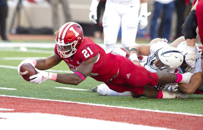 Indiana running back Stevie Scott (21) makes a diving effort to score during the second half of an NCAA college football game against Penn State Saturday, Oct. 20, 2018, in Bloomington, Ind. Penn State won 33-28. (AP Photo/Doug McSchooler)