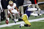 FILE - In this Saturday, Nov. 14, 2020, file photo, Notre Dame linebacker Jeremiah Owusu-Koramoah, right, breaks up a pass intended for Boston College wide receiver Zay Flowers (4) during the first half of an NCAA college football game in Boston. Owusu-Koramoah was voted The Associated Press defensive player of the year for the Atlantic Coast Conference and was one of nine Notre Dame selections to the AP all-ACC team. (AP Photo/Michael Dwyer, File)