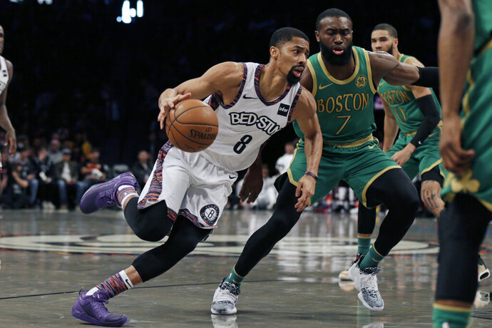 Brooklyn Nets guard Spencer Dinwiddie (8) drives to the basket past Boston Celtics guard Jaylen Brown (7) during the first half of an NBA basketball game Friday, Nov. 29, 2019, in New York. (AP Photo/Adam Hunger)