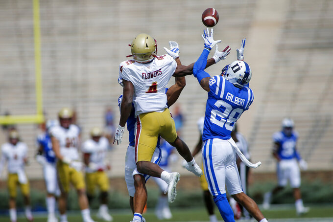 Duke cornerback Mark Gilbert (28) intercepts a pass intended for Boston College wide receiver Zay Flowers (4)  during the first half of an NCAA college football game, Saturday, Sept. 19, 2020, in Durham, N.C. (Nell Redmond/Pool Photo via AP)
