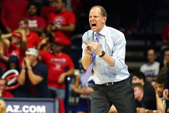 Washington coach Mike Hopkins yells to players during the second half of the team's NCAA college basketball game against Arizona on Saturday, March 7, 2020, in Tucson, Ariz. Washington won 69-63. (AP Photo/Rick Scuteri)