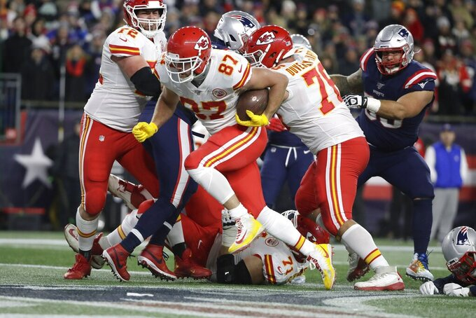 Kansas City Chiefs tight end Travis Kelce runs into the end zone for a touchdown in the first half of an NFL football game against the New England Patriots, Sunday, Dec. 8, 2019, in Foxborough, Mass. (AP Photo/Elise Amendola)