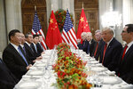 FILE - In this Dec. 1, 2018, file photo, U.S. President Donald Trump, second right, meets with China's President Xi Jinping, left, during their bilateral meeting at the G20 Summit, in Buenos Aires, Argentina. Chinese and U.S. trade negotiators are in contact on ways of resolving disputes ahead of an expected meeting between their heads of state at the G-20 summit in Japan later this week, a Chinese official said Monday, June 24, 2019. (AP Photo/Pablo Martinez Monsivais, File)