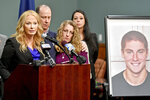 FILE - In this May 5, 2017, file photo, Centre County, Pa., District Attorney Stacy Parks Miller, left, announces findings an investigation into the death of Penn State University fraternity pledge Tim Piazza (in photo at right) as his parents, Jim and Evelyn Piazza, second and third from left, stand nearby during a news conference in Bellefonte, Pa. A judge on Friday, Feb. 9, 2018, scheduled a six-day preliminary hearing in March 2018 for 11 Penn State fraternity brothers facing refiled charges in the Feb. 4, 2017, death of the 19-year-old Piazza, of Lebanon, N.J., after a night of heavy drinking. (Abby Drey/Centre Daily Times via AP, File)