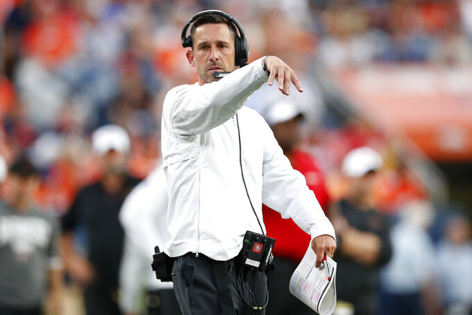 San Francisco 49ers head coach Kyle Shanahan throws the red flag during an NFL preseason football game against the Denver Broncos, Monday, Aug. 19, 2019, in Denver. (AP Photo/David Zalubowski)