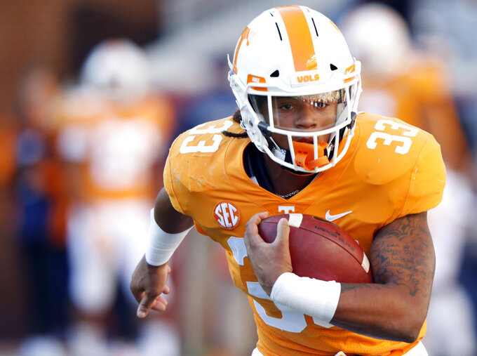 Tennessee running back Jeremy Banks (33) participates in warmups before an NCAA college football game against Missouri Saturday, Nov. 17, 2018, in Knoxville, Tenn. (AP Photo/Wade Payne)