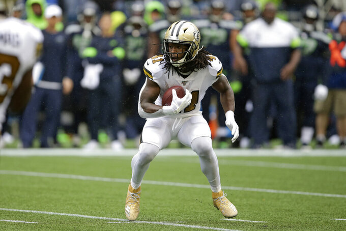 New Orleans Saints' Alvin Kamara carries the ball against the Seattle Seahawks during the first half of an NFL football game Sunday, Sept. 22, 2019, in Seattle. (AP Photo/Scott Eklund)