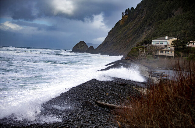 In this Sunday, Jan. 12, 2020 photo, waves crash along the shore of Falcon Cove Beach between the unincorporated community of Arch Cape to the north and Oswald West State Park to the south in Clatsop County, Ore. A 7-year-old girl is dead and her 4-year-old brother is missing after they and their father were swept into the ocean on the Oregon coast amid a high-surf warning. Authorities say the father was holding the two children when a wave swept all three into the water Saturday, Jan. 11 in the Falcon Cove area, south of the community of Cannon Beach. (Mark Graves/The Oregonian via AP)
