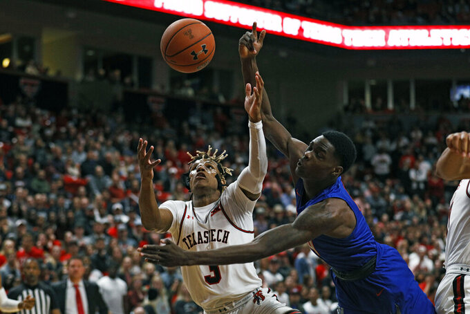 Tennessee State's Wesley Harris (4) and Texas Tech's Jahmi'us Ramsey (3) try to rebound the ball during the first half of an NCAA college basketball game Thursday, Nov. 21, 2019, in Lubbock, Texas. (AP Photo/Brad Tollefson)